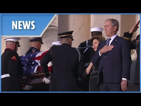 Emotional George W. Bush watches his fathers casket arrive at Capitol