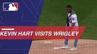 Comedian Kevin Hart tosses the first pitch and sings during the 7th-inning stretch