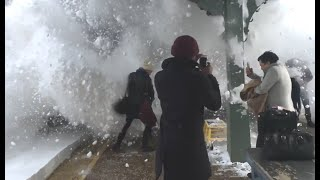Train Pushes Wave Of Snow At People