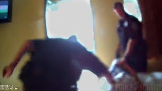 Bodycam Video Of Officer Hitting Handcuffed Suspect in