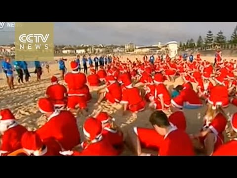 Surfing Santas set world record in Australia