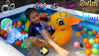 Funny Toddler Play With Colorful Balls and Toys in Inflatable Pool