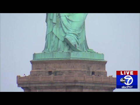 Woman climbs Statue of Liberty and 2 hour standoff follows