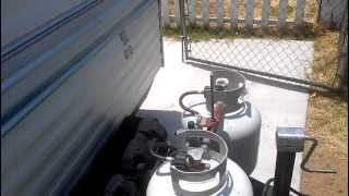 How to start up the propane refrigerator on a trailer.