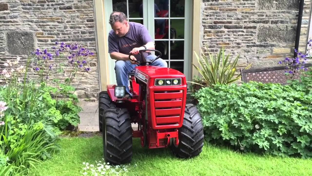 Raider 16 articulated 4x4 wheel horse tractor - YouTube