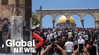 Palestinian protesters clash with Israeli police outside Al-Aqsa mosque in Jerusalem