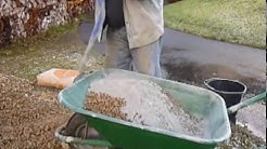 Mixing concrete by hand in a wheelbarrow the easy way