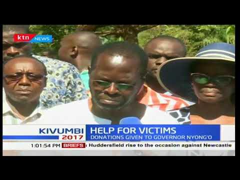 Kisumu post poll chaos victims receive food donations from Nairobi businessmen