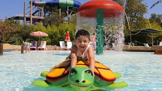 Yusuf plays in the aquapark
