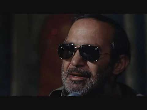 Ben Gazzara as Charles Bukowski explains