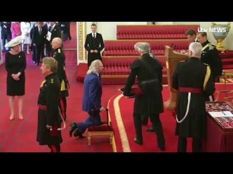 Bee Gees star Sir Barry Gibb reveals he struggled to get to his feet after being knighted  ITV News