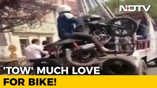 WATCH: Biker Towed Along With His Bike In Kanpur, Video Will Make You Laugh(What do you do when traffic violators don't cooperate with law enforcement? Just take them with you - that seems to be the mantra for the traffic police in Kanpur., 2017-03-09T08:58:35.000Z)