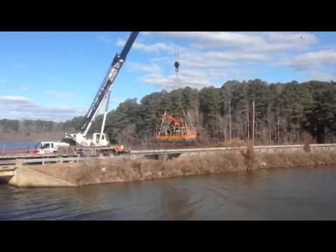 Crane Lifts Barge Over Highway