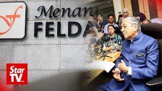PM questions Moody's negative rating on Felda aid