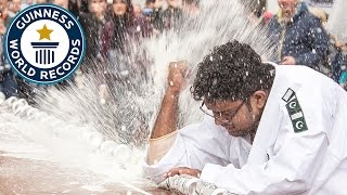 Most drinks cans crushed with the elbow in one minute - Guinness World Records
