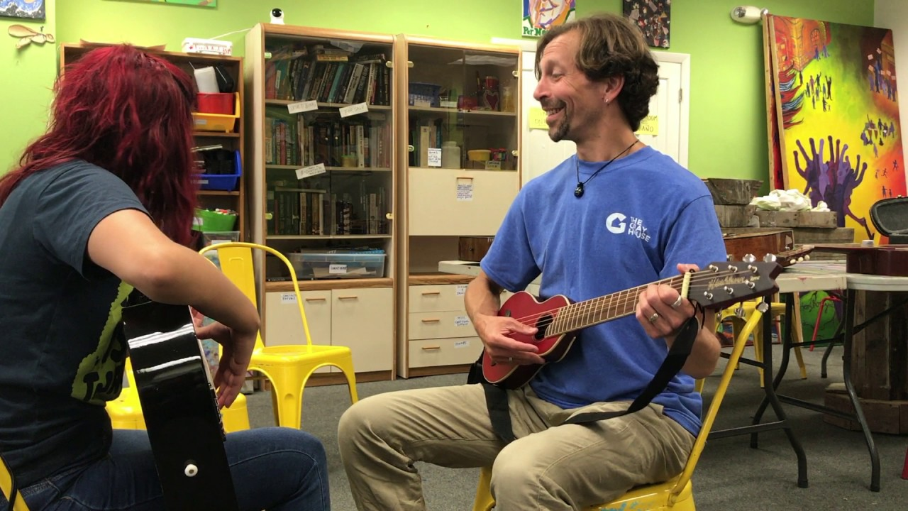Learning English by learning guitar: Community Guitar Program