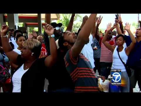 First night of Ferguson curfew ends in tear gas, 7 arrests