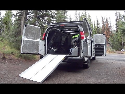 Work and Live Off-Grid in this VAN - Tiny House (Motorcycle Strores Inside Too!)