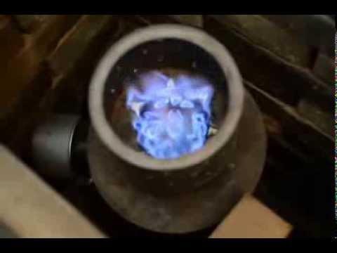 Blue Flame Burning Charcoal From Wood Pellets In A Tlud