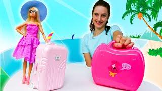 Barbie et Ken vont à la plage. Faisons la valise. Vidéo en français pour les filles.