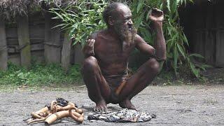 Dani tribe man selling kotekas