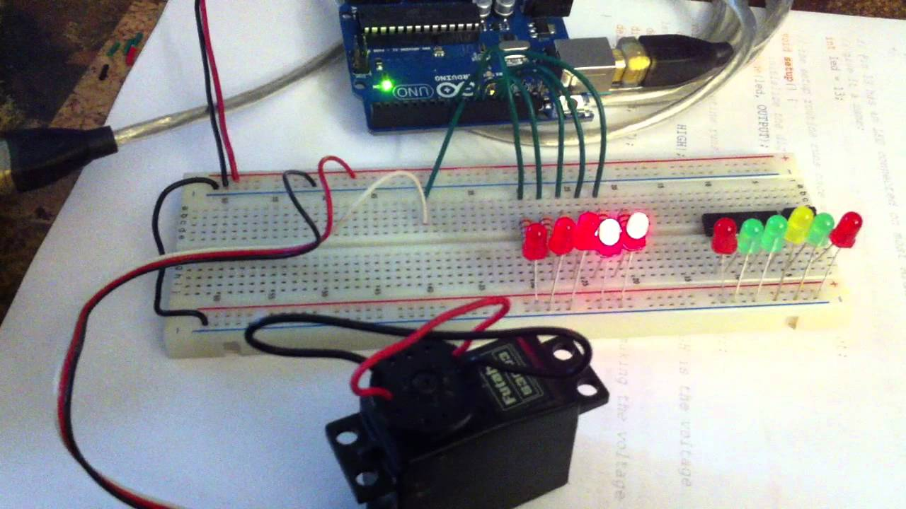 Arduino uno running a servo with led position indicators
