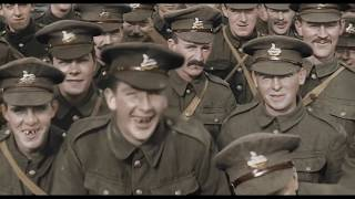 WWI restored and colored footage 100 years old. End of war announced.