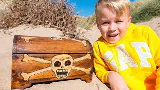 Gaby and Alex playing on the beach and Found Toy Pirate Treasures