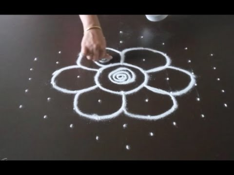 Simple flower kolam with 9 Dots to 5 interlaced