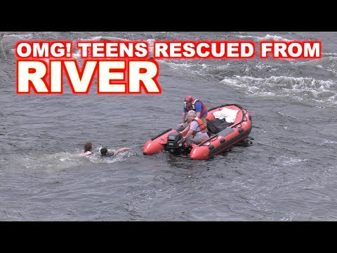 TEENS RESCUED FROM RAGING RIVER