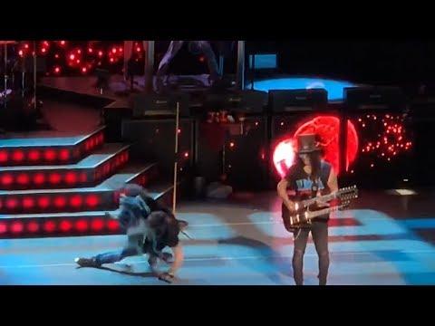 Axl Rose Takes A Hard Fall During Guns N' Roses Show
