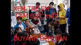 Photography trainingXEM TRẺ EM CÂM ĐIẾC HÁT ...DUYANH ĐỆM ĐÀN GUITAR