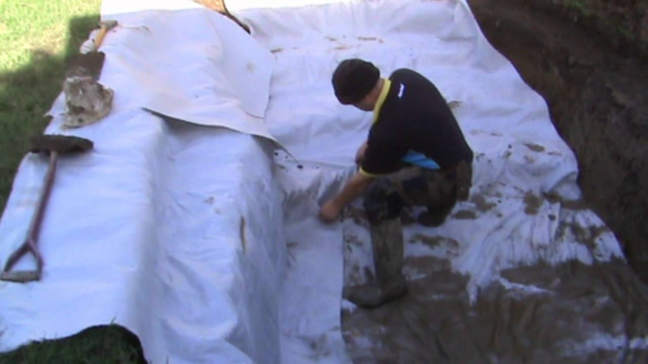 how to build a fish pond part 1 digging the hole and laying the
