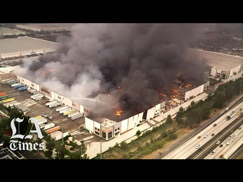 A Three-alarm Fire Tore Through A Warehouse In Redlands Briefly Closing A Stretch Of The 10 Freeway