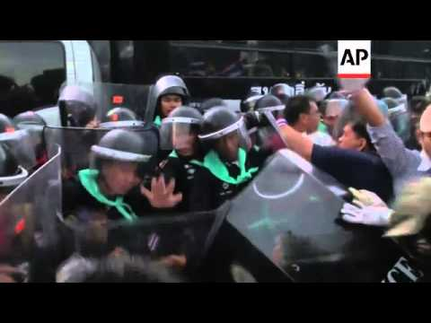 Huge crowds of protesters in Thailand clashed with riot police in Bangkok. The protesters are callin