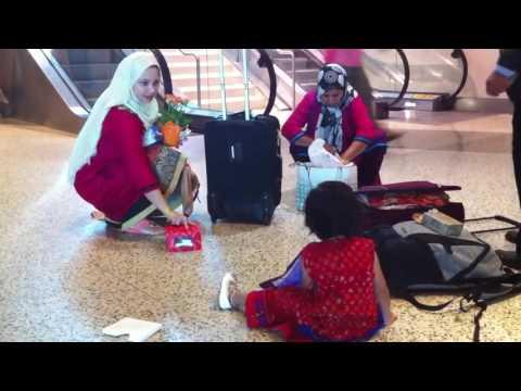 Amina at airport