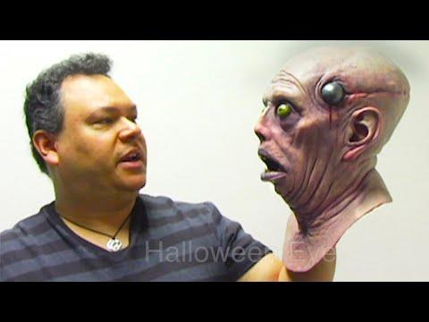 Jordu Schell shows Ed Edmunds of Distortions his Latex Masks