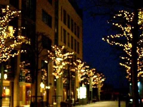 Aker Brygge at night .