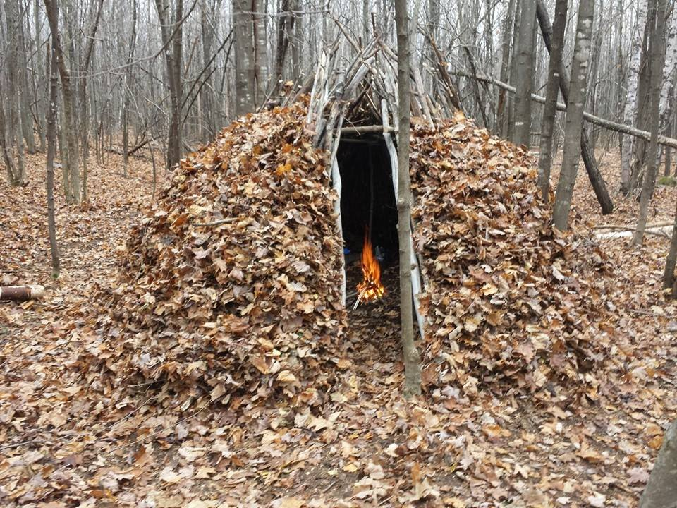 Bushcraft forest group shelter youtube for Making hut with waste material