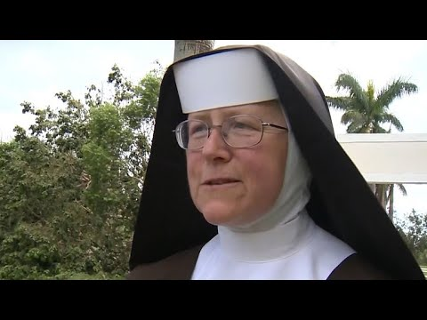Nun clears downed trees from Irma with a chain saw