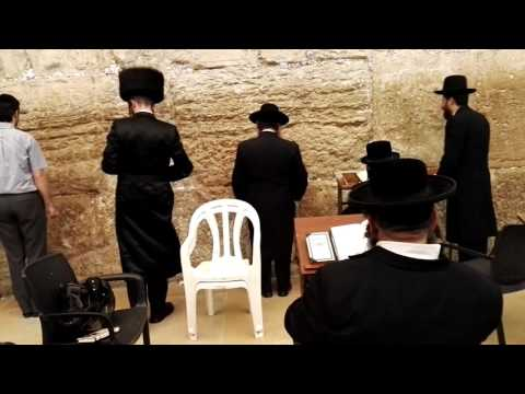 The Western Wall (Wailing Wall) - an Orthodox Jewish prayer. Jerusalem. Israel