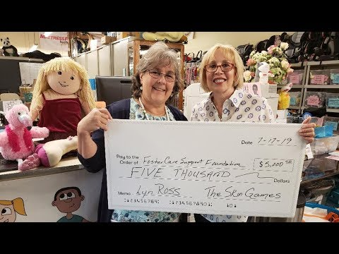 Lyn Ross presents Foster Care Support Foundation with Donation