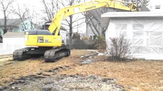 Demolition of Sears Asbestos Panelized Kit Home.