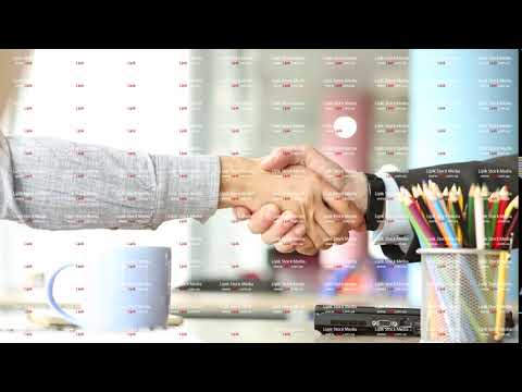 Handshake of two business partners in modern office space.