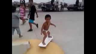 2 Years Old Baby Skateboarding With His Baby Pants On :p