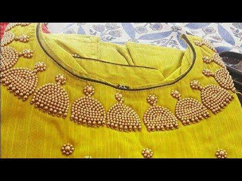 Very elegant and attractive jhumka design neckline using normal needle same like aari/maggam work