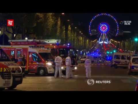 Deadly shooting shuts down the Champs Elysees in Paris