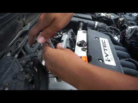 how to change spark plugs on a honda ; ignition coils as well.