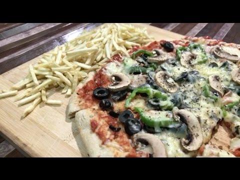 صورة  طريقة عمل البيتزا طريقة عمل بيتزا الخبز السريعه - وصفات بنت الهاشمي طريقة عمل البيتزا من يوتيوب