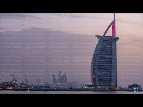 Dubai skyline with Burj Al Arab hotel day to night timelapse.